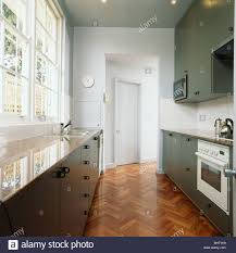 White Galley Kitchen Pictures Parquet Flooring In Modern White Galley Kitchen With Gray Fitted