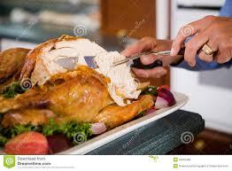 thanksgiving carving slices of roast turkey for dinner stock