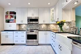 black and white tile backsplash blue kitchen cabinets gray grey