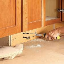kitchen cabinet baseboards how to build cabinet drawers increase kitchen