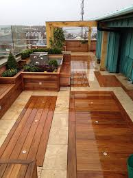 Small Patio Flooring Ideas by Exterior Green Outdoor Balcony Flooring Idea With Iron White