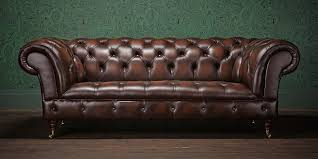 decor wallpaper and chesterfield couch with wood flooring for