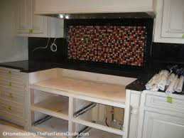 how to put up tile backsplash in kitchen a fantastic glass tile backsplash idea plus tips on diy