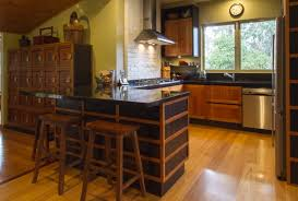 black kitchen island u shape and wooden stools in japanese kitchen