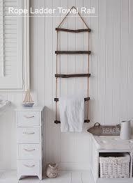 A Uniquw Way Of Storing Towels With This Rope Towel Ladder
