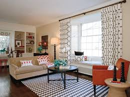 Geometric Printed Window Treatment With Beige Couch And Orange - Family room window ideas