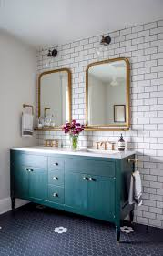 bathroom remodel with gold mirrors and faucets schoolhouse