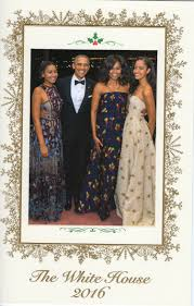 malia and sasha sparkle in the obama family u0027s new christmas card