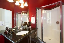 modern bathroom design ideas pictures tips from hgtv fun with white toilet and laminate flooring mirror also wooden chair red wall table with chandelier as well bathroom