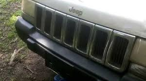 wrecked black jeep grand cherokee how to replace your grill on a 1998 jeep grand cherokee youtube