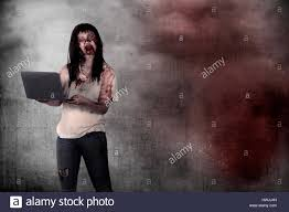free digital background halloween female zombie holding laptop over grunge background halloween
