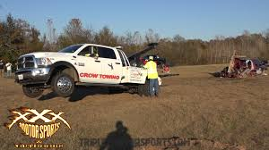 mega truck giant mega truck tows big mega truck to mud bog and they play like