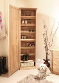 tall natural brown wooden shoe storage cabinet with single door