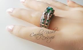 engagement rings skull crafted skull engagement ring with green emerald gems by