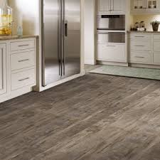 wood look linoleum woodgrain tile in herringbone pattern wood