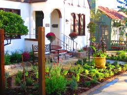 captivating vegetable garden with gravel floor and driveway design