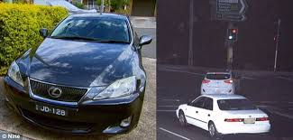 fine for running a red light driver stung with 439 red light fine but he was 50km away daily
