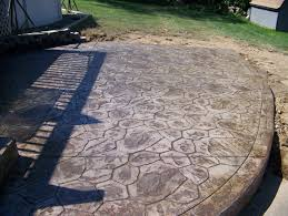 grey motif concrete floor patio with green grass yard and white