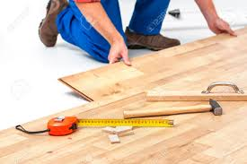 How To Lay Laminate Hardwood Flooring Carpenter Worker Installing Laminate Flooring In The Room Stock