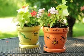 fingerprint flower pots kids can make as a garden gift