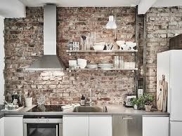 exposed brick kitchen splashback kitchen island enveloped by white