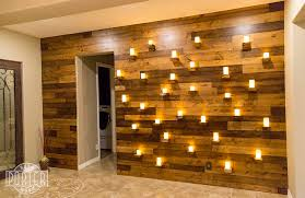 3 tone knotty alder wood wall covering with live edge shelves