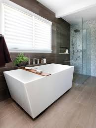 this modern style bathroom with glass shower and geometric bath
