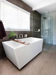 this modern style bathroom with glass shower and geometric bath modern bathroom design