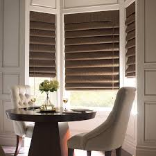 decorating brown levolor vertical blinds matched with curtains