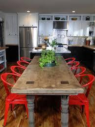 black pendant light wooden kitchen island orange kitchen cabinet