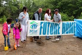habitat for humanity partner family commemorate new home build