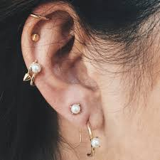 earrings on top of ear ear cuff trio nyc