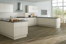 good looking u shape kitchen featuring cream color wooden kitchen