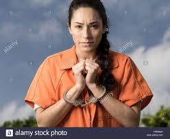 Prison Jumpsuit Woman Wearing Handcuffs And Orange Prison Jumpsuit Stock Photo