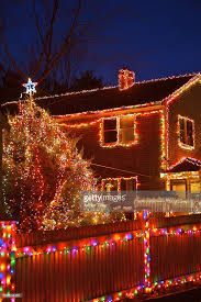 christmas lights on house tree fence stock photo getty images