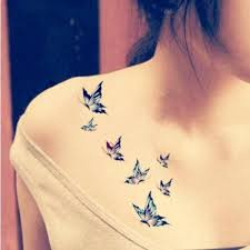 two little bats tattoo behind girls ear photos pictures and
