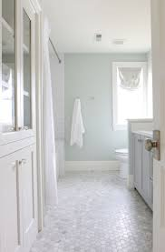 large white fiberglass tubs mixed black ceramic floor as well f the midway house guest bathroom sherwin williams sea salt sea