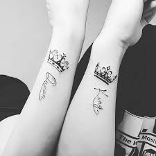 adorable king and queen matching tattoos on wrist