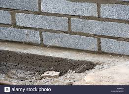 bricklaying wall with half cement breeze blocks building a block