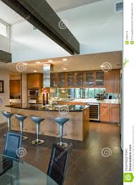 spacious kitchen with stools at island in house royalty free stock
