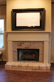 half brick fireplace surround with elevated hearth home decor