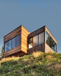 green roofed house in the hills