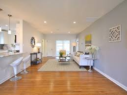 contemporary living room with hardwood floors by violet star home