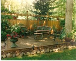 backyard privacy wall with deck attached landscaping decks