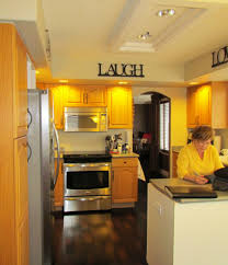 Modernize Kitchen Cabinets Oak Kitchen Remodel U2013 Painted Cream Cabinets And Quartz