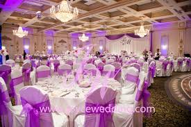purple and white wedding reception with theme colour on purple and white light