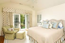 creamy white wall color and nice curtain with valances for nice
