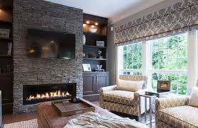 stone fireplaces pictures stacked stone fireplace designs and the decors around them