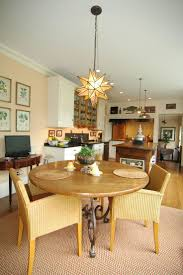 a small dining area in this open galley kitchen provides a