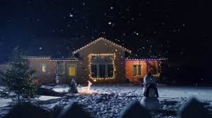 christmas lights that look like snow falling a residential north american house decorated with christmas lights